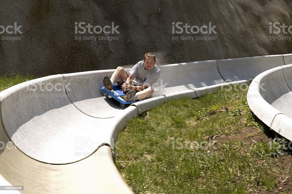 Blazing Down the Alpine Slide stock photo