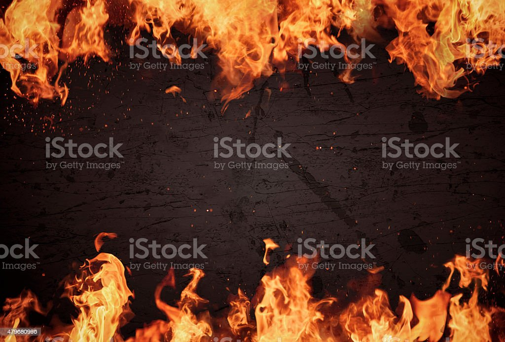 Blazing flames over dark background stock photo
