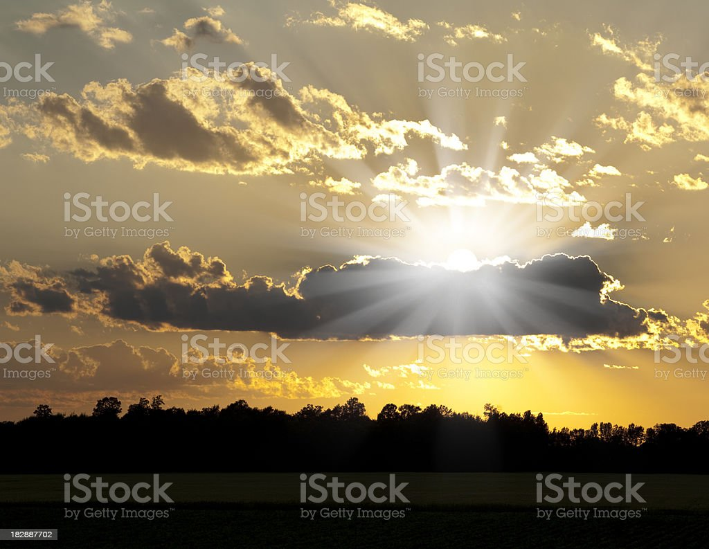 Blazing Hot Summer Sun Is Cradled in Dusk Clouds royalty-free stock photo