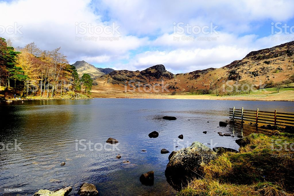 Blea Tarn and surrounding fells stock photo