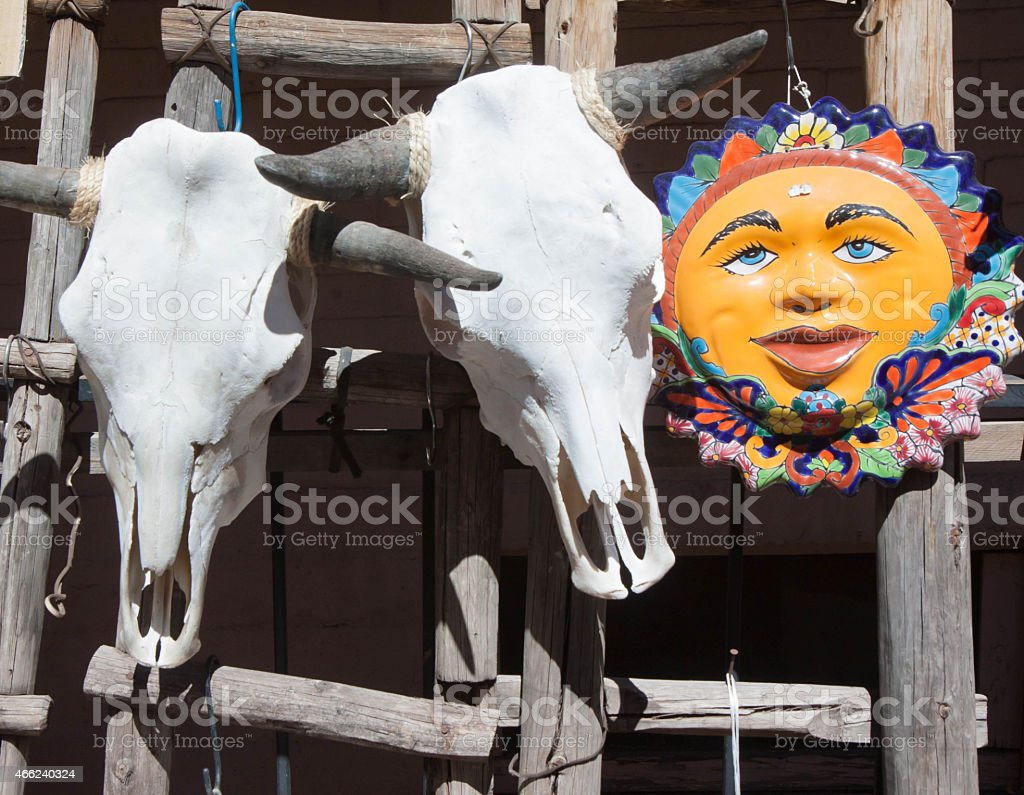 Bleached Cow Skulls and Ceramic Sun souvenirs in Santa Fe stock photo