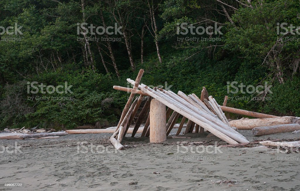 Bleached logs stacked into rustic camp stock photo