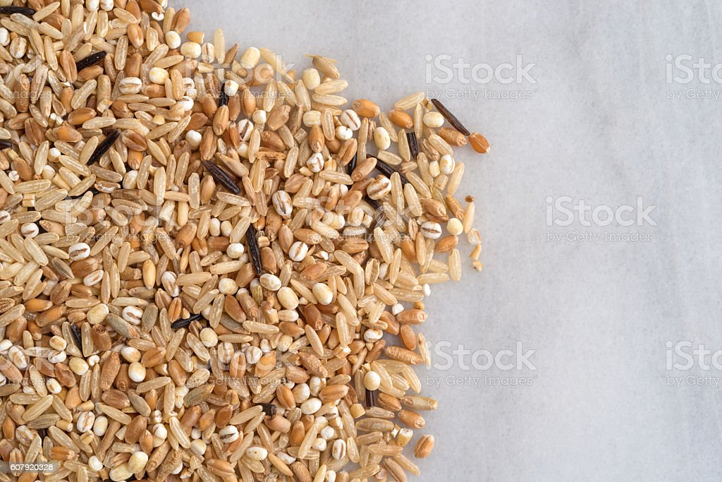 Blend of rice and grains on a marble cutting board stock photo
