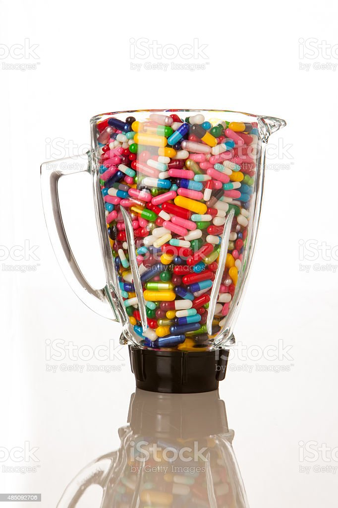 Blender filled with pills and capsules stock photo