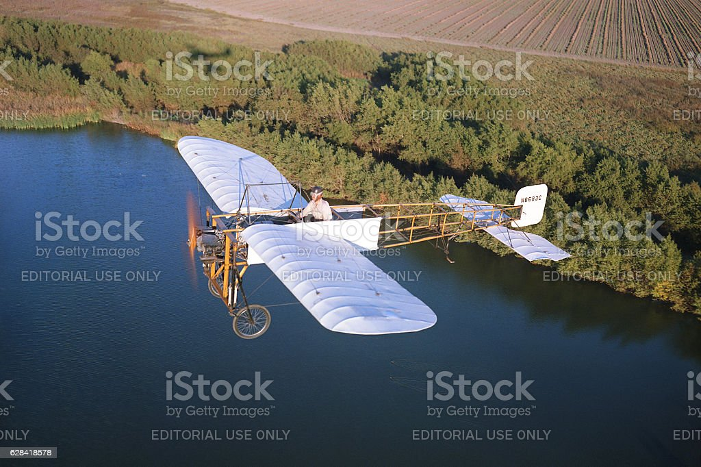 Bleriot XI 1909 airplane in flight stock photo