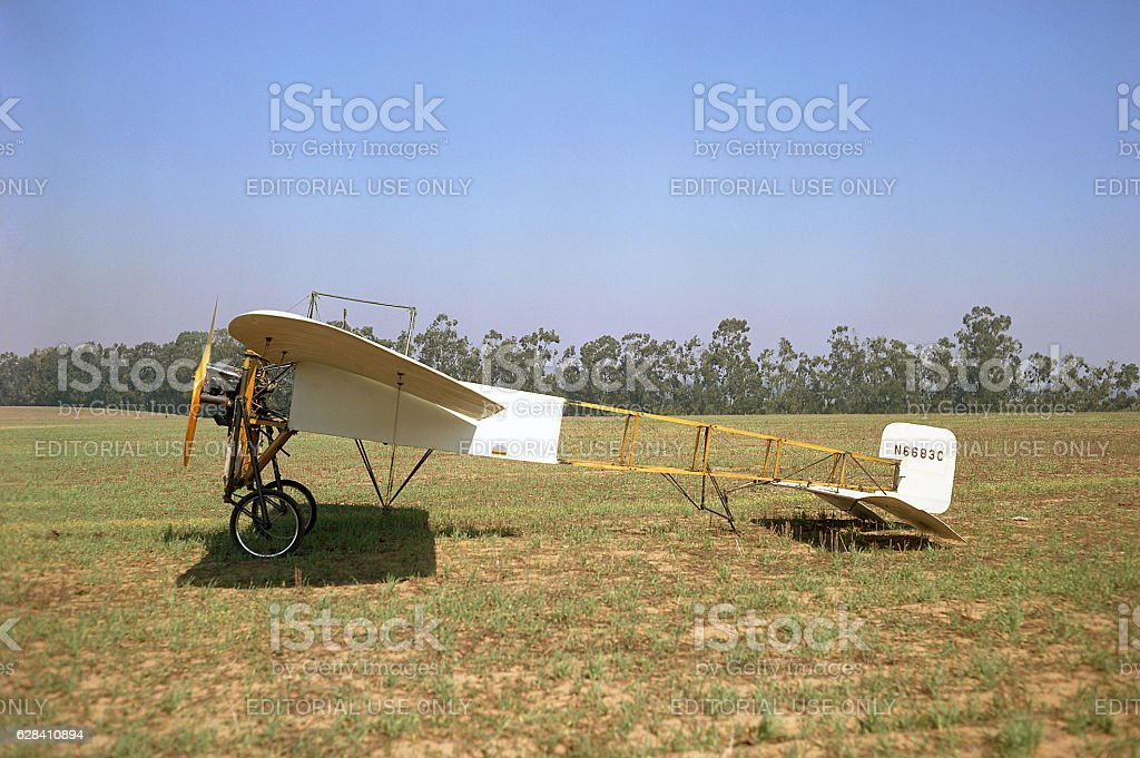 Bleriot XI 1909 airplane sitting in grass field stock photo