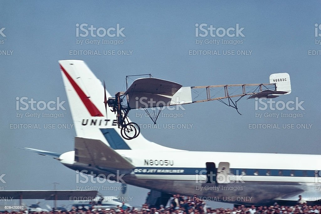 Bleriot XI and Douglas DC-8 airplanes stock photo