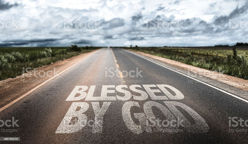 Blessed By God written on rural road stock photo