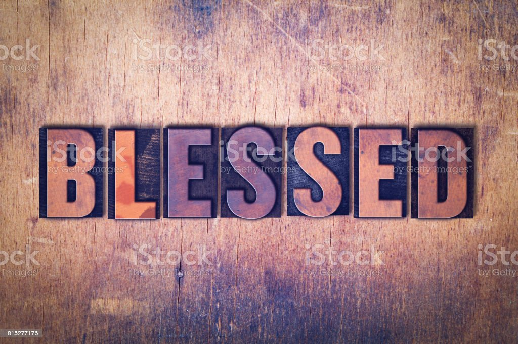 Blessed Theme Letterpress Word on Wood Background stock photo