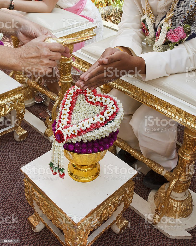 Blessed water at Thai wedding ceremony royalty-free stock photo