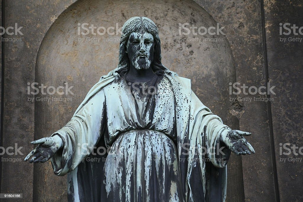 Blessing Christ statue in a cemetery stock photo