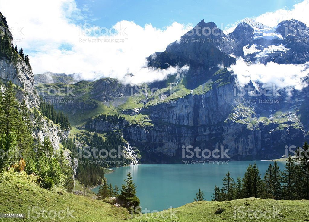Bleu waters of the Oeschinensee lake in Switzerland stock photo