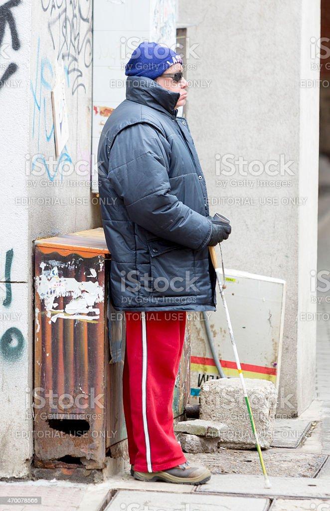 Blind man begging stock photo