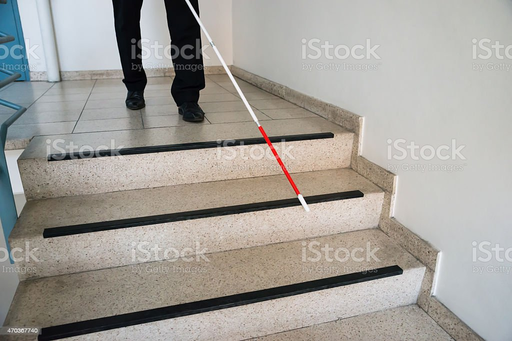 Blind Man Moving Down On Stairway stock photo