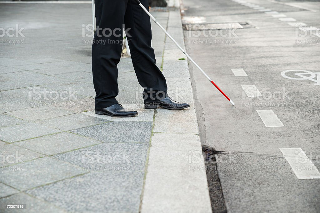 Blind Person Crossing Street stock photo