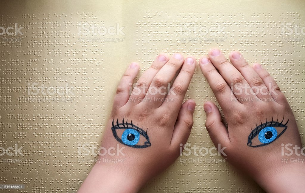 Blind reading text in braille stock photo