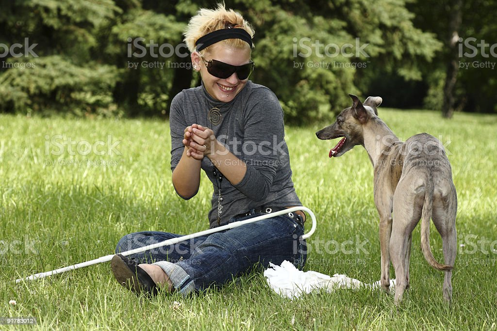 blind woman playing with her dog stock photo