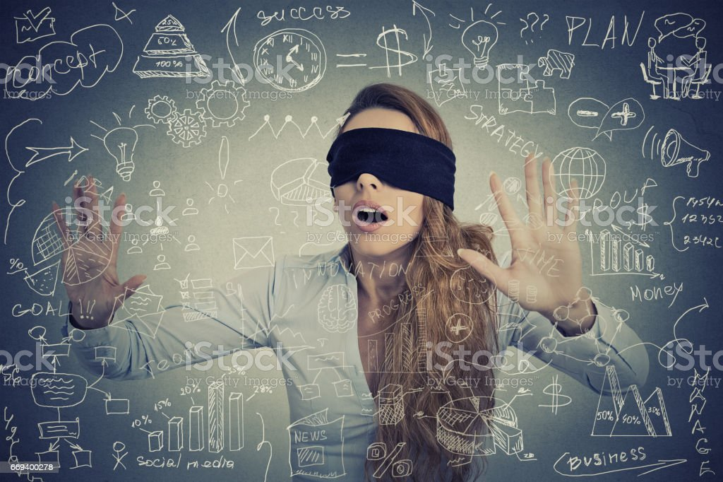 Blind young businesswoman making plans stock photo