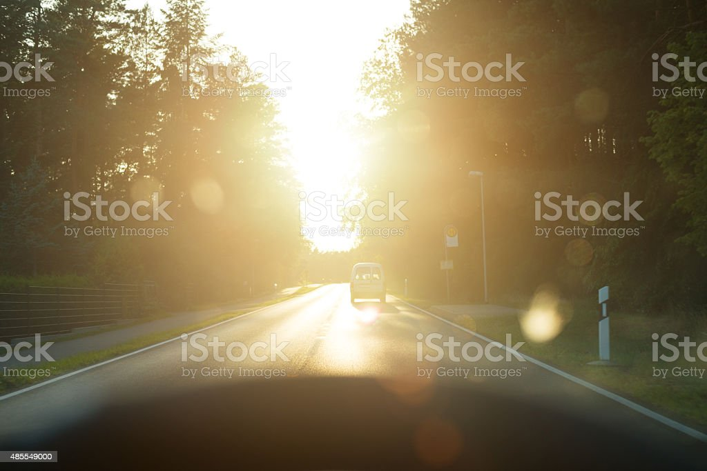 Blinded by sunlight while driving in car - accident danger stock photo