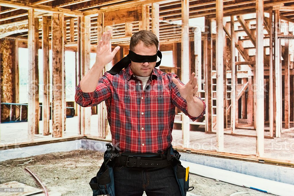 Blindfold building contractor searching stock photo