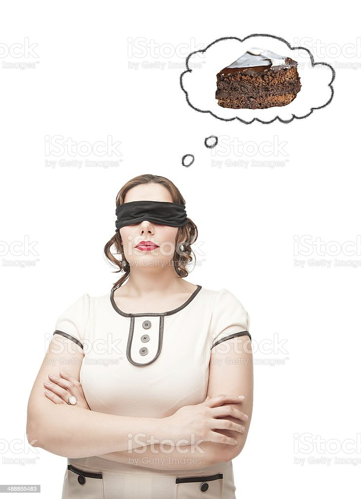Blindfold plus size woman dreaming about cake stock photo