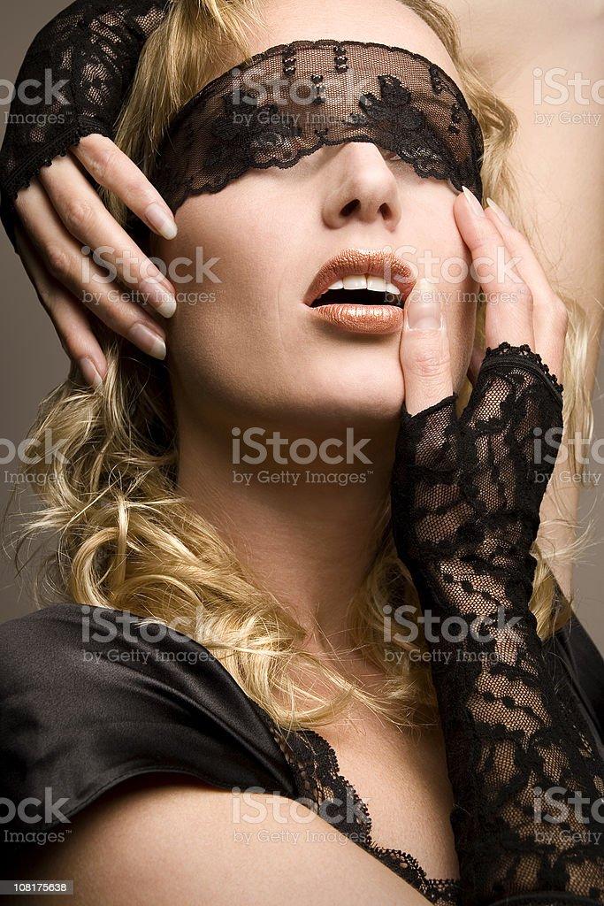 Blindfolded beauty royalty-free stock photo