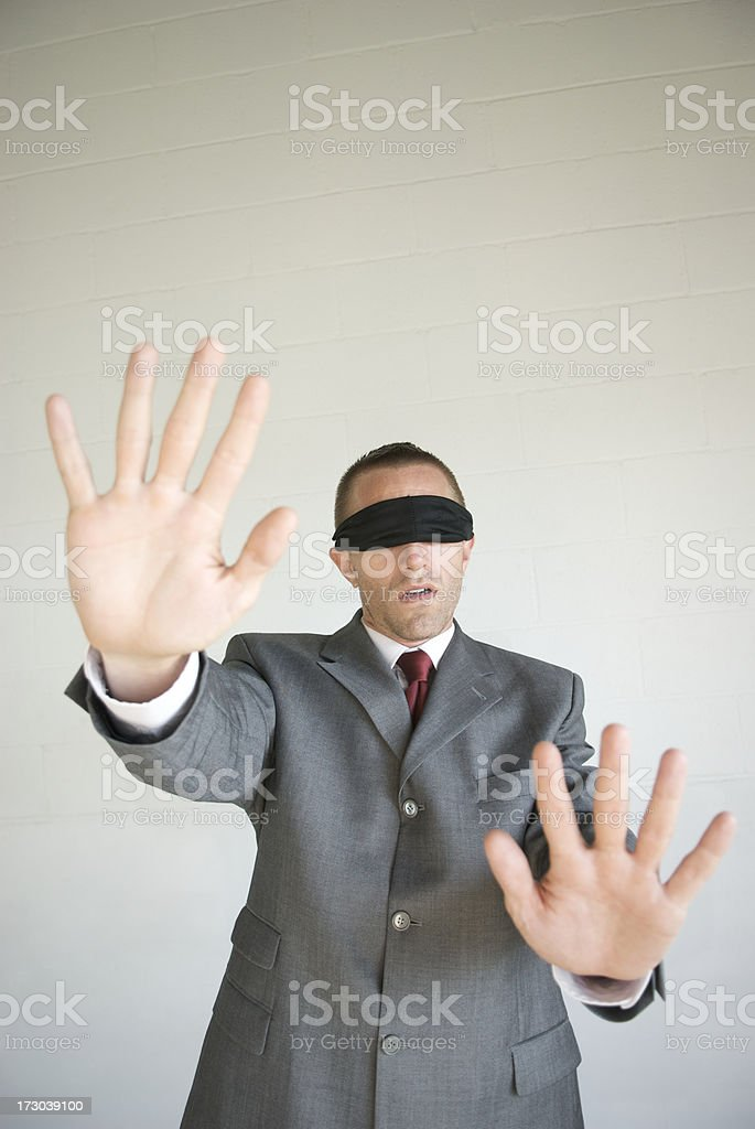 Blindfolded Businessman Gropes Forward royalty-free stock photo