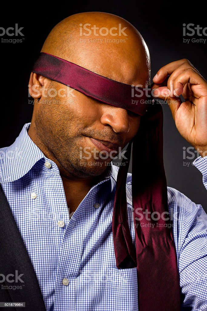 Blindfolded Businessman With Necktie stock photo