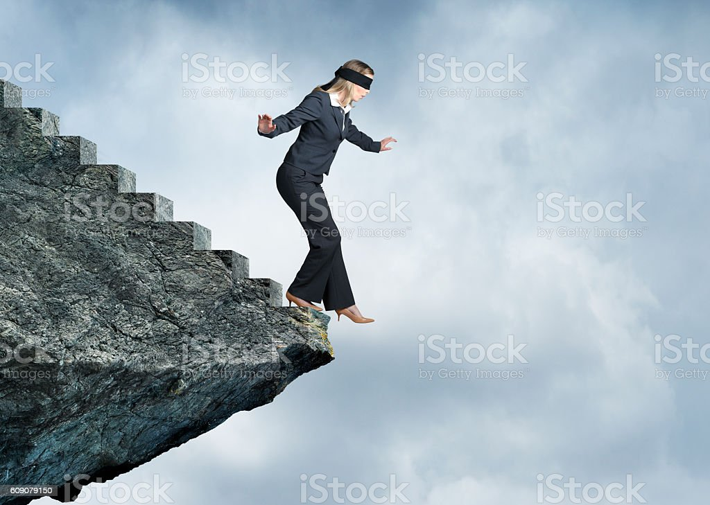 Blindfolded Businesswoman About To Step Off Stairs stock photo