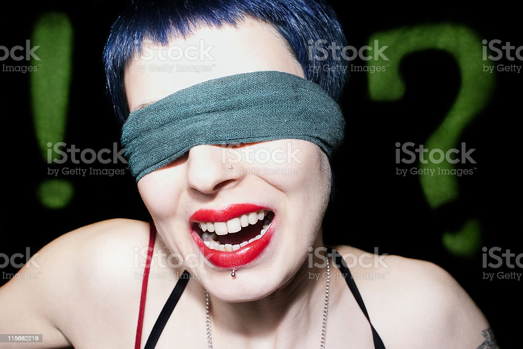 blindfolded lady and piercing, mouth open, smiling royalty-free stock photo
