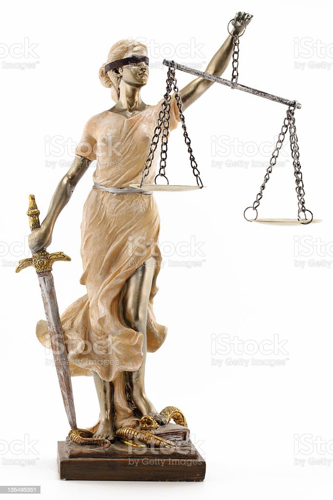 Blindfolded Lady Justice statue on a white background stock photo