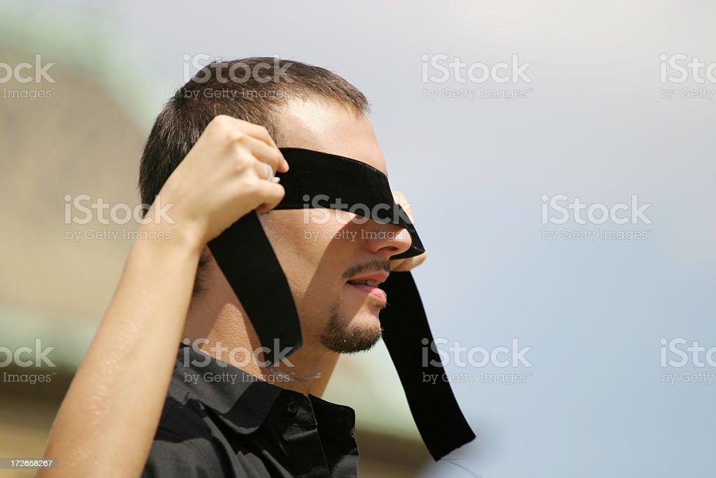 Blindfolded royalty-free stock photo