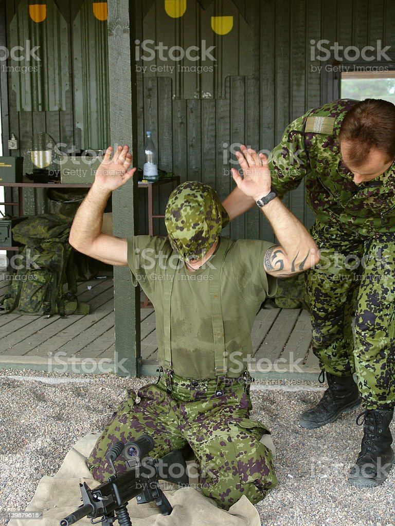 Blindfolded soldier fitting together his weapon royalty-free stock photo
