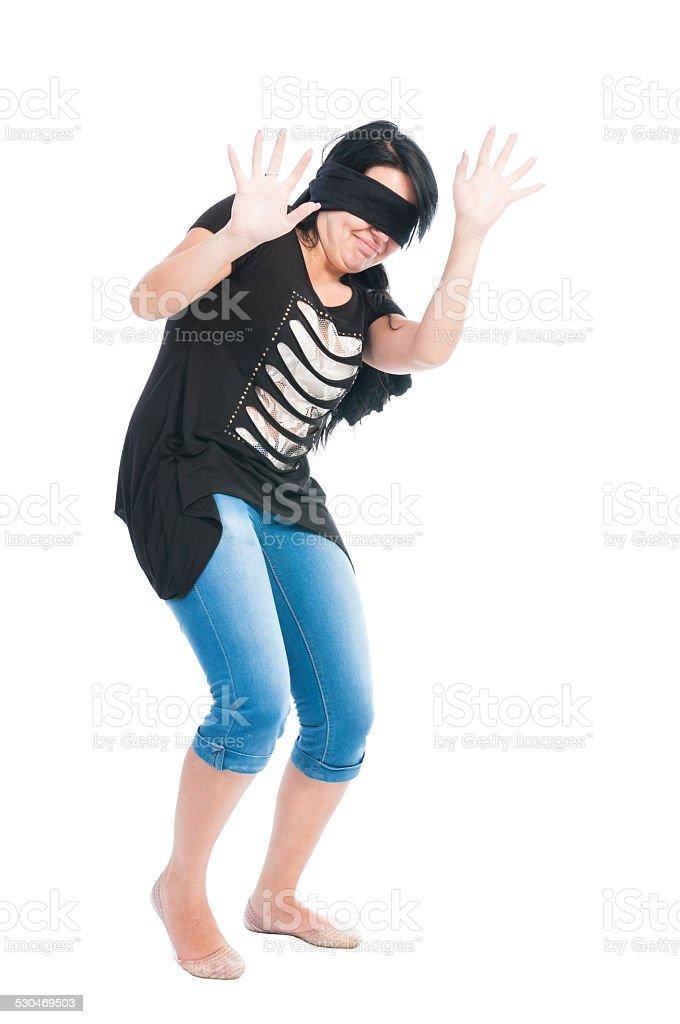 Blindfolded teen girl acting scared stock photo