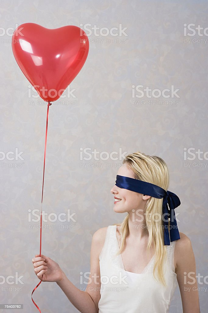 Blindfolded woman with balloon royalty-free stock photo