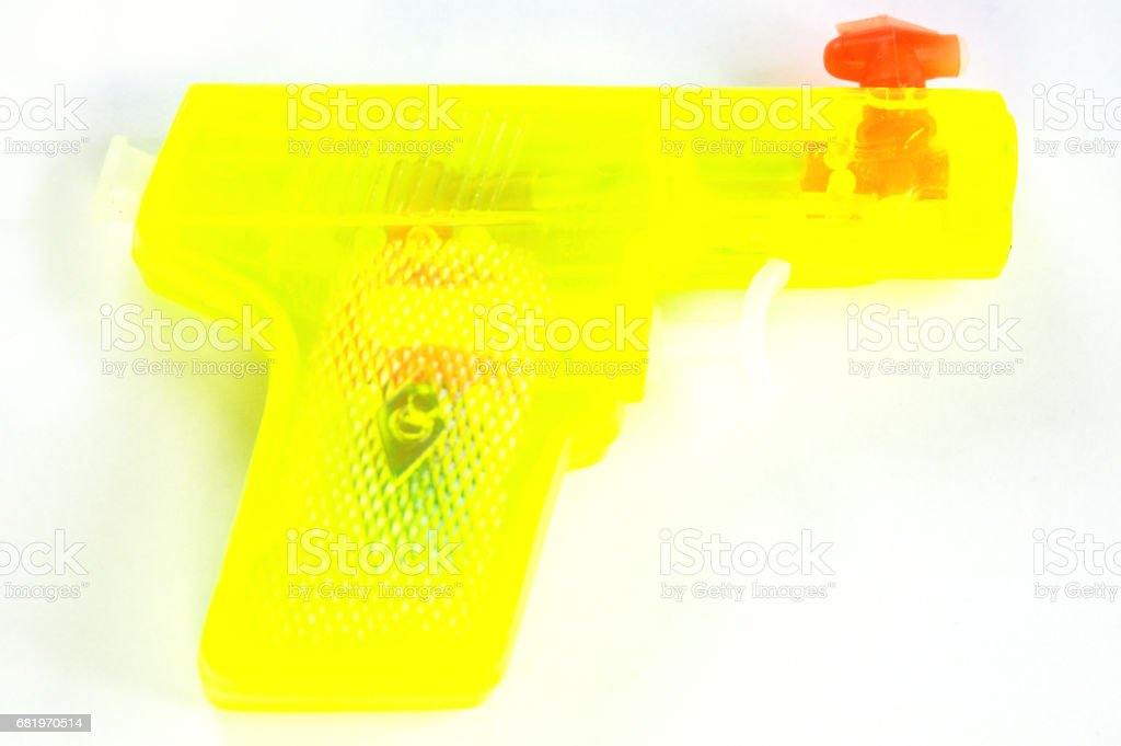 Blindigly yellow water gun isolated on white stock photo