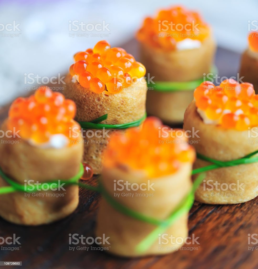 Blini and Red Caviar Appetizers stock photo