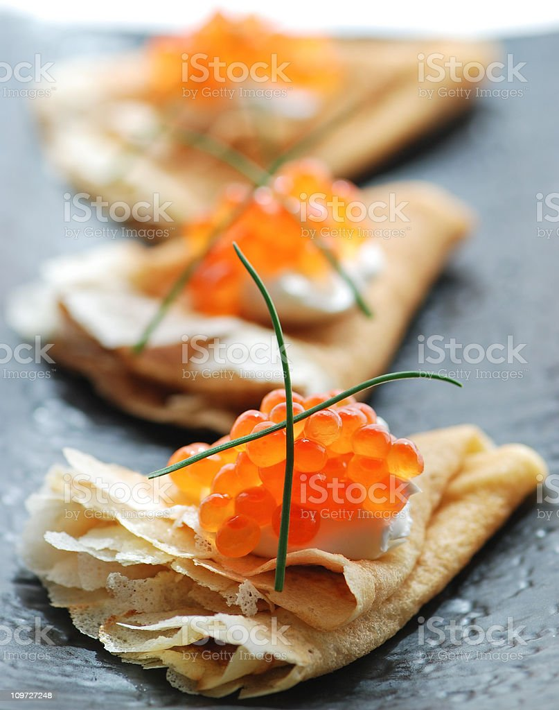 Blini with red caviar stock photo