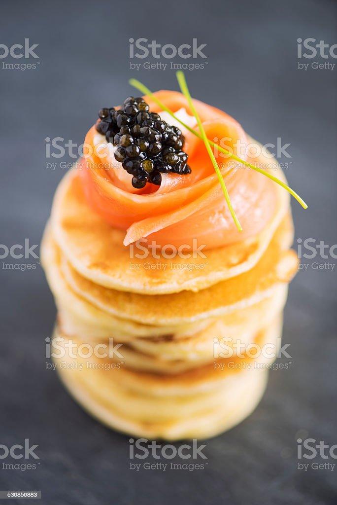 Blini with Smoked Salmon and Caviar stock photo