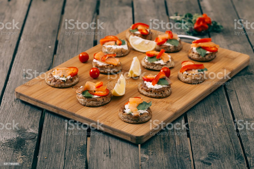 Blinis in wooden vintage table stock photo