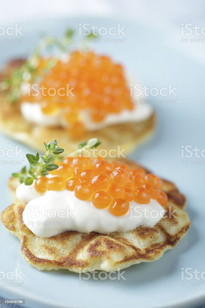 Blinis with red caviar stock photo