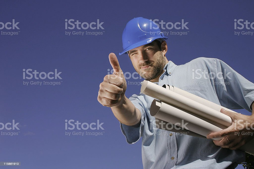 Blinking engineer with blue helmet royalty-free stock photo