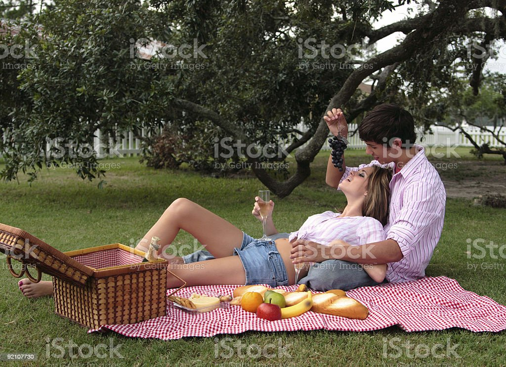 Bliss and Daniel: Teasing with grapes. royalty-free stock photo