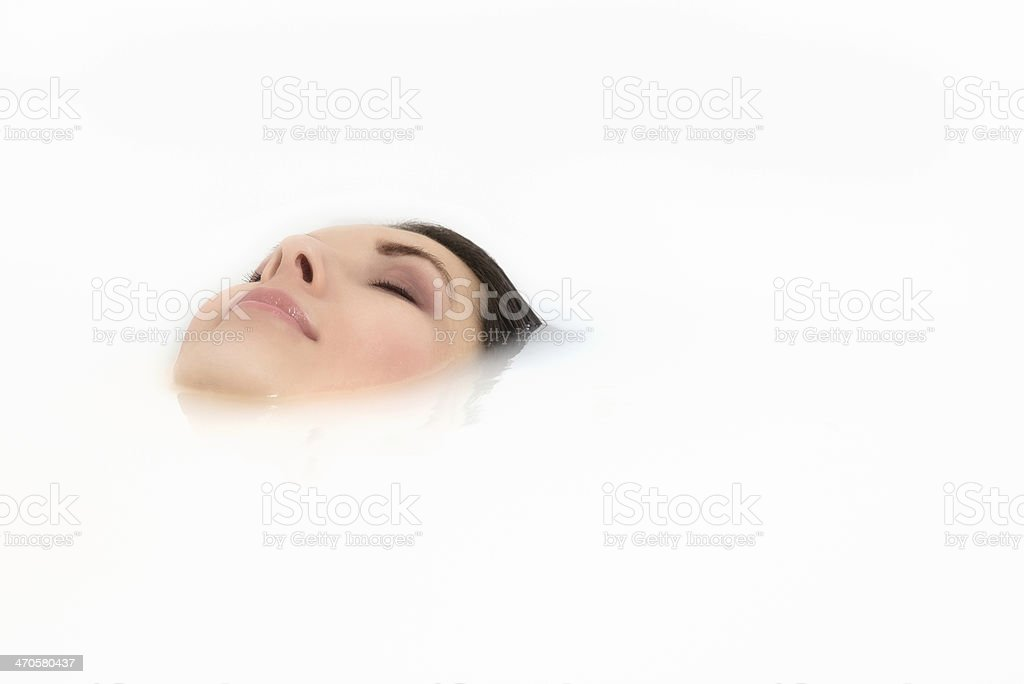 Blissful woman soaking in a hot bath stock photo
