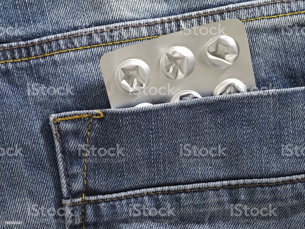 Blister pack in blue jean pocket stock photo