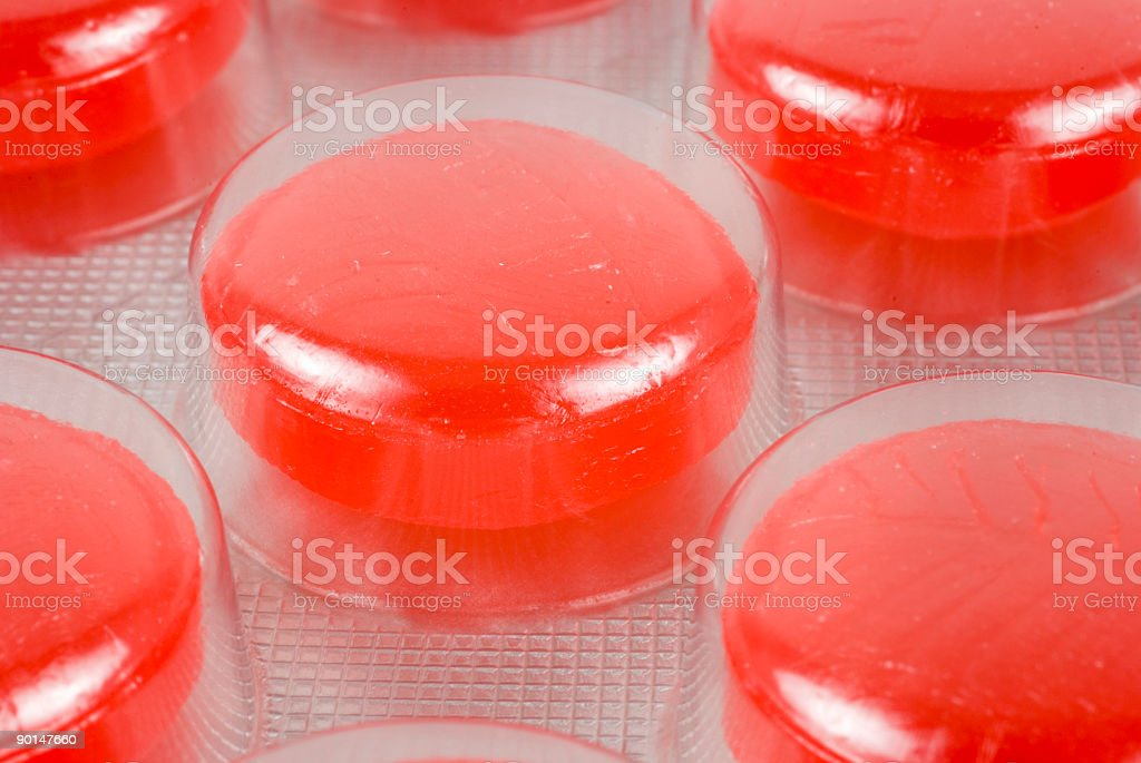 Blister Series. Pack macro with red candies royalty-free stock photo