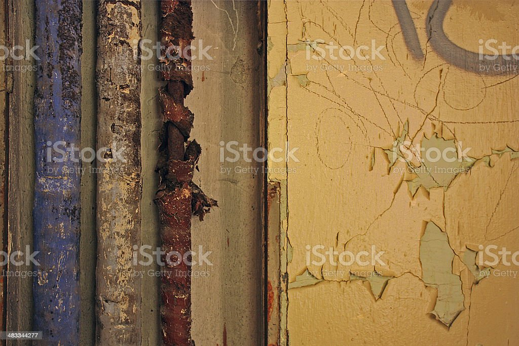 Blistered tubes in abandoned house stock photo