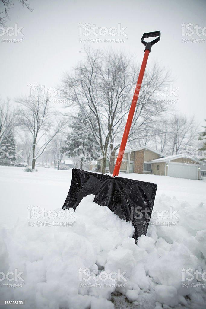 Blizzard and Snow Shovel royalty-free stock photo