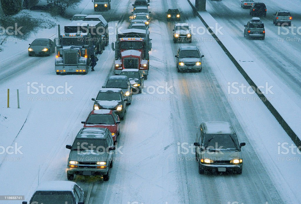 Blizzard at Rush Hour: People Traveling in Winter stock photo
