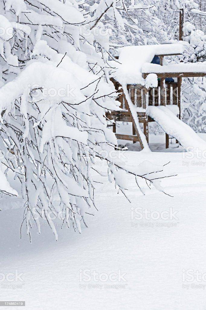 Blizzard Buried Back Yard Swingset stock photo